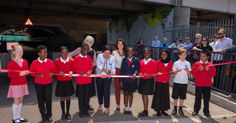 Mayor Rokhsana Fiaz and pupils from Star Primary School cut the ribbon to unveil a new work of art